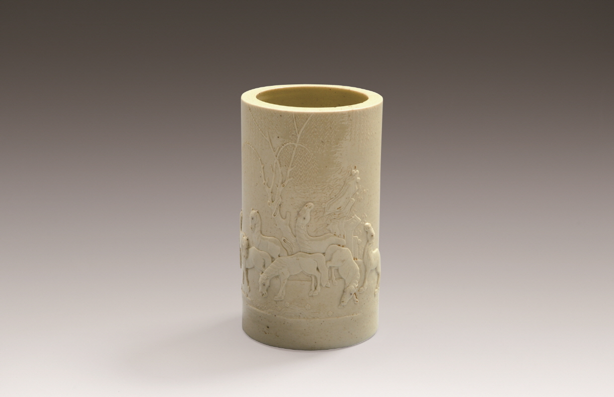 A Rice-Yellow-Glazed 'Eight Horses' Brushpot by Chenguo Zhi, Daoguang period, H13 W7.5
