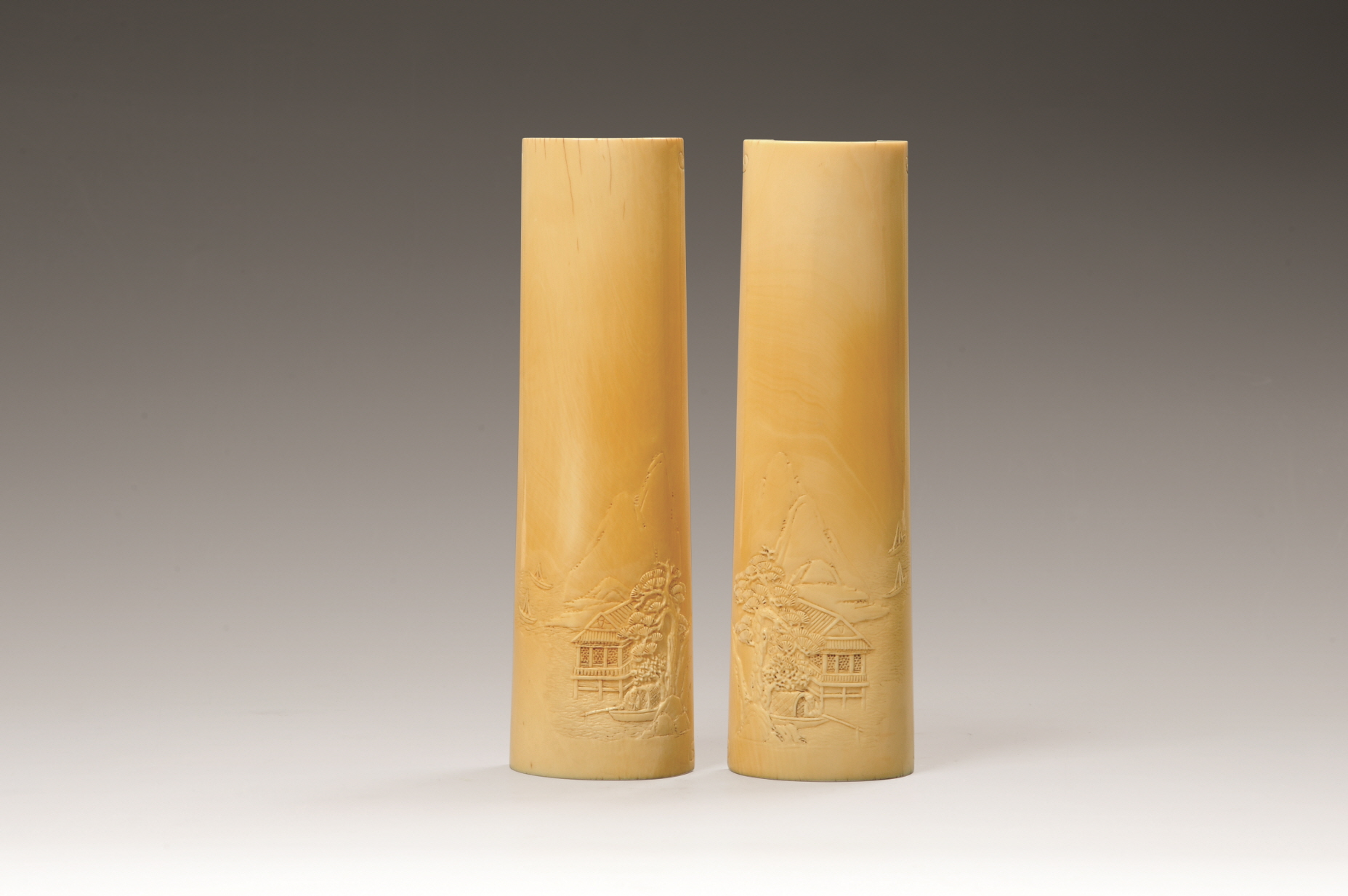 A Pair of Ivory Wrist Rests Carved with 'Eight Immortals Crossing the Sea' Design, Qing Dynasty, H21.9 W6.6 (1)