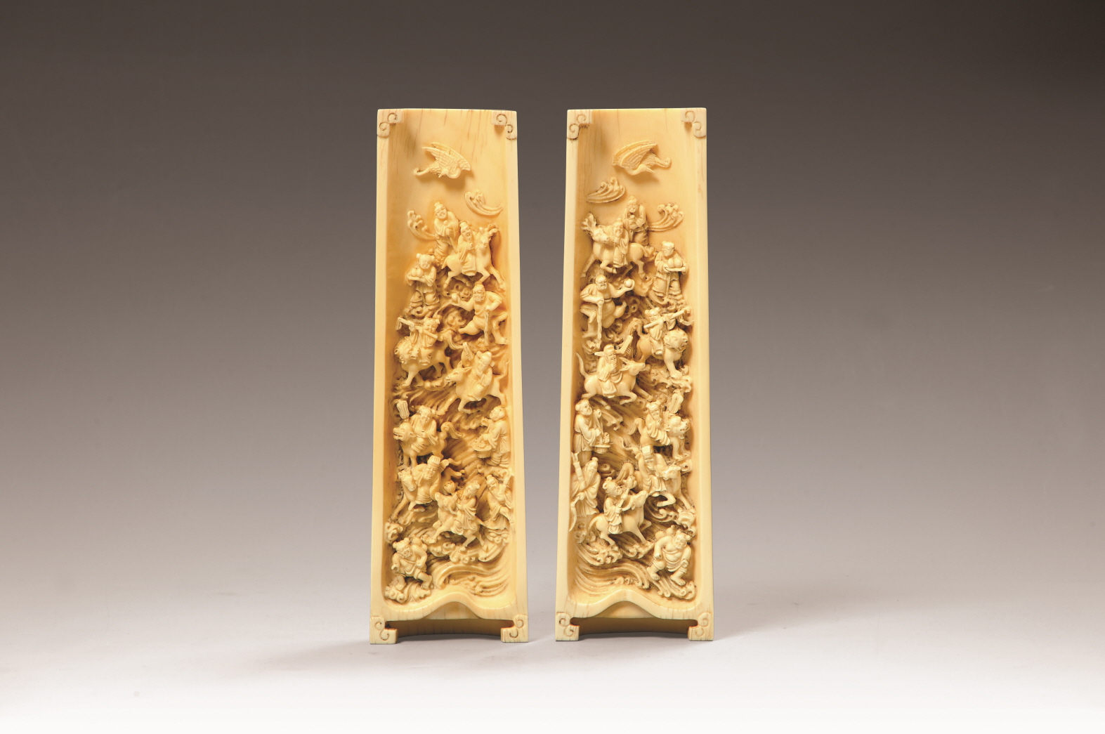 A Pair of Ivory Wrist Rests Carved with 'Eight Immortals Crossing the Sea' Design, Qing Dynasty, H21.9 W6.6 (2)